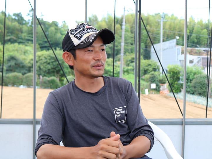 話をする田丸さん